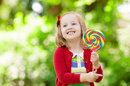 smiling child with candy